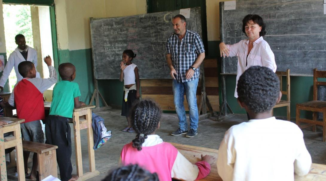 Older volunteer run a sing along class with the students at our volunteer teaching placements in Madagascar
